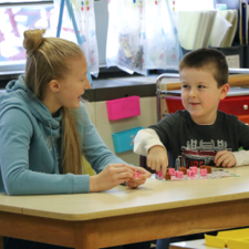 High School Honor Society Members Volunteer in Elementary Classrooms